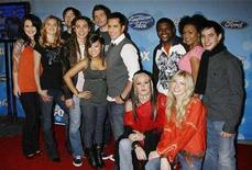 """<p>Finalists (L-R) Carly Smithson, Kristy Lee Cook, David Cook, Ramiele Malubay, Jason Castro, Michael Johns, David Hernandez, Chikezie, Amanda Overmyer, Brooke White, Syesha Mercado and David Archuleta pose at the American Idol Top 12 party honoring the finalists in the 'American Idol"""" television reality series in Los Angeles, California March 6, 2008. REUTERS/Fred Prouser</p>"""