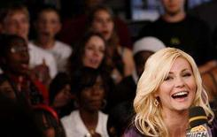 """<p>Elisha Cuthbert is interviewed at the MuchMusic television station to promote her upcoming movie """"Captivity"""" in Toronto June 22, 2007. REUTERS/Mark Blinch</p>"""