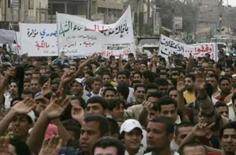 <p>Manifestantes apoíam al-Sadr no distrito de Kadhimiya, em Bagdá. Photo by Ceerwan Aziz</p>