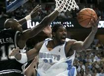 <p>O pivô do Denver Nuggets Nenê Hilário (foto de arquivo) voltou a disputar uma partida da NBA, na noite de quinta-feira, após ter sido operado em janeiro para a retirada de um câncer do testículo. Na volta do brasileiro, o Nuggets derrotou o Dallas Mavericks por 118 a 105.. Photo by Rick Wilking</p>
