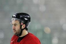 <p>Canadian men's Olympic ice hockey team player Todd Bertuzzi skates during a practice session at the Torino 2006 Winter Olympic Games in Turin, Italy February 17, 2006. REUTERS/Mike Blake</p>