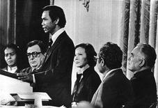 "<p>Photojournalist Dith Pran, speaks at a meeting of the National Cambodia Crisis Committee at the White House as First Lady Rosalynn Carter (3rd R), wife of President Jimmy Carter, looks on in this January 29, 1980 file photo. Pran, whose harrowing experiences in Cambodia under the Khmer Rouge were dramatized in the film ""The Killing Fields,"" died on Sunday at the age of 65. He died of pancreatic cancer at a New Brunswick, New Jersey, hospital, The New York Times said on its Web site. REUTERS/The New York Times/Handout</p>"