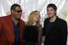 """<p>The cast of """"21"""", Laurence Fishburne (L), Kate Bosworth (C) and Jim Sturgess, pose in a pressroom before the 2008 ShoWest Awards ceremony in Las Vegas, Nevada March 13, 2008. he new gambling drama played a winning hand at the weekend box office in North America, earning an estimated $23.7 million in its first round, distributor Columbia Pictures said on Sunday. REUTERS/Steve Marcus</p>"""