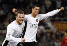 <p>Manchester bate Roma e fica perto da semi na Liga dos Campeões. Os atacantes Cristiano Ronaldo e Wayne Rooney marcaram pelo Manchester United na vitória do time inglês por 2 x 0 sobre a Roma no estádio Olímpico pela primeira partida das quartas-de-final da Liga dos Campeões. 1o de abril. Photo by Giampiero Sposito</p>