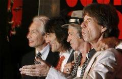 """<p>Rolling Stones band members Keith Richards (2nd R), Mick Jagger (R), Ronnie Wood (2nd L) and Charlie Watts smile as they arrive at the premiere of the documentary film """"Shine A Light"""" about them directed by Martin Scorsese in New York March 30, 2008. REUTERS/Lucas Jackson</p>"""
