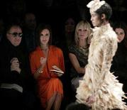 <p>Project Runway judges designer Michael Kors (L) and Victoria Beckham (2nd L) and host Heidi Klum watch the Project Runway fashion show at New York Fashion Week February 8, 2008. REUTERS/Carlo Allegri (</p>