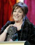 """<p>Carmen Maura smiles after receiving a """"Goya"""" award during the Spanish Film Academy """"Goya"""" awards ceremony in Madrid January 28, 2007. REUTERS/Andrea Comas</p>"""