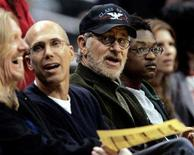 <p>Producer Jeffrey Katzenberg (2nd L) and director Steven Speilberg (C, with cap and glasses) watch the from courtside as the Los Angeles Lakers defeated the Philadelphia 76ers, 119-93, during their NBA game in Los Angeles January 6, 2006. REUTERS/Robert Galbraith</p>