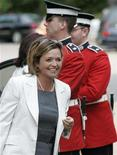 <p>Josee Verner (L) arrives to be sworn-in as Canada's Heritage Minister at Rideau Hall in Ottawa August 14, 2007. REUTERS/Patrick Doyle</p>