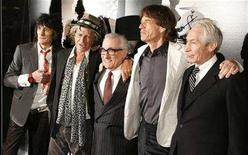 """<p>Director Martin Scorsese (C) stands with Rolling Stones band members Keith Richards (2nd L), Mick Jagger (2nd R), Ronnie Wood (L), and Charlie Watts as the group arrives at the premiere of the documentary film """"Shine A Light"""", directed by Scorsese about the Rolling Stones, in New York March 30, 2008. REUTERS/Lucas Jackson</p>"""