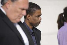 <p>Comedian Chris Rock (C) leaves the courthouse after testifying in the trial of Anthony Pellicano in Los Angeles April 4, 2008. Pellicano, a Hollywood private investigator, is facing multiple charges including illegal wiretapping. REUTERS/Phil McCarten</p>