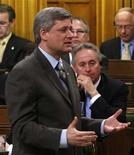 <p>Canada's Prime Minister Stephen Harper (front) speaks during Question Period as Conservative Member of Parliament Tom Lukiwski looks on, in the House of Commons on Parliament Hill in Ottawa April 7, 2008. REUTERS/Chris Wattie</p>