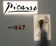 <p>A man walks in front of an engraving by Pablo Picasso, at an exhibition in the northern port city of Thessaloniki February 22, 2008.REUTERS/Grigoris Siamidis</p>