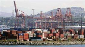 <p>Shipping containers are seen on docks in Vancouver in a 2005 file photo. REUTERS/Andy Clark</p>