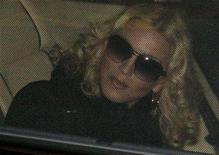<p>Madonna sits in a limousine after a news conference in Berlin, February 13, 2008. Madonna is expected to appear in a Malawian court in about two weeks for a final ruling on whether she can adopt a child from the southern African country, court clerks said on Friday. REUTERS/Tobias Schwarz</p>