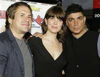 """<p>(L-R) Cast members John Melendez and Bellamy Young poses with director Michael DeLorenzo as they arrive for the premiere of """"National Lampoon Presents One, Two, Many"""" in Los Angeles April 10, 2008. REUTERS/Danny Moloshok</p>"""