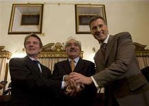 <p>France's Foreign Minister Bernard Kouchner (L), Afghan Foreign Minister Rangeen Dafar Spanta (C) and Canada's Foreign Minister Maxime Bernier put their hands together after a news conference in Kabul April 12, 2008. REUTERS/Ahmad Masood</p>