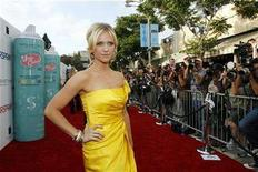 """<p>Cast member Brittany Snow poses at the premiere of """"Hairspray"""" at the Mann Village theatre in Westwood, California July 10, 2007. REUTERS/Mario Anzuoni</p>"""