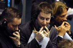 <p>Trader al lavoro alla Borsa di Londra. REUTERS/Dylan Martinez (BRITAIN)</p>
