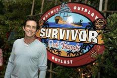 <p>Jeff Probst, the host of 'Survivor: Cook Islands', poses for photographers after taping the show's season finale in Los Angeles December 17, 2006. REUTERS/Max Morse</p>