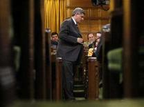 <p>Canada's Prime Minister Stephen Harper stands to speak during Question Period in the House of Commons on Parliament Hill in Ottawa April 9, 2008. REUTERS/Chris Wattie</p>