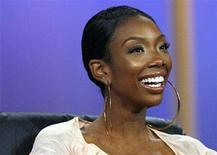 """<p>Brandy smiles at the panel for the NBC television show """"America's Got Talent"""" at the """"Television Critics Association"""" summer 2006 media tour in Pasadena, California, July 21, 2006. REUTERS/Mario Anzuoni</p>"""