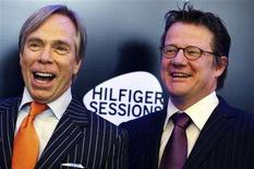 <p>Designer Tommy Hilfiger (L) and Sony BMG Europe's head Maarten Steinkamp pose for photographers during the global launch of TommyTV in central London April 16, 2008. REUTERS/Alessia Pierdomenico</p>
