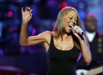 """<p>Singer Mariah Carey performs at the """"Idol Gives Back"""" show at the Kodak theatre in Hollywood, California April 6, 2008. REUTERS/Mario Anzuoni</p>"""