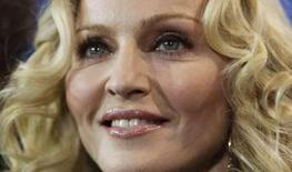 <p>Pop star Madonna poses during a photocall to present her film 'Filth And Wisdom' running at the 58th Berlinale International Film Festival in Berlin February 13, 2008. Madonna has asked a Malawian court to delay a hearing to finalize her adoption of a boy from the southern African nation, a lawyer close to the case said. REUTERS/Hannibal Hanschke</p>