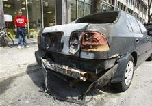 <p>A damaged car is seen in downtown Montreal April 22, 2008. REUTERS/Shaun Best</p>