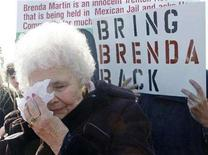 <p>Marjorie Bletcher, mother of Brenda Martin, a Canadian woman who has been sitting in a Mexican jail for two years without a trial, wipes away tears during a demonstration on Parliament Hill in Ottawa March 29, 2008. REUTERS/Chris Wattie</p>