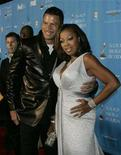 <p>Star Jones Reynolds (L) and husband Al Reynolds (2nd L) arrive at the taping of the 37th annual NAACP Image Awards in Los Angeles, California February 25, 2006. REUTERS/Fred Prouser</p>