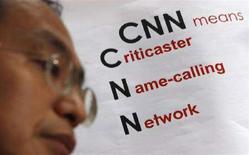 <p>Una protesta anti-Cnn fuori dalla sua sede di Hong Kong. REUTERS/Bobby Yip (CHINA)</p>