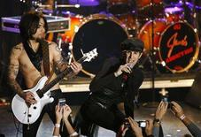 <p>Lead Singer Perry Farrell (R) and guitarist Dave Navarro of Jane's Addiction perform at the 2008 NME Awards USA at El Rey theatre in Los Angeles April 23, 2008. The original line-up of the rock band took the stage for the first time in 17 years. REUTERS/Mario Anzuoni</p>