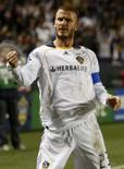 <p>Meia do Los Angeles Galaxy David Beckham comemora gol da equipe em partida da MLS na Califórnia, em 19 de abril. Photo by Lucy Nicholson</p>