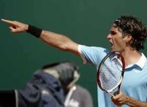 <p>Tenista número 1 do mundo Roger Federer comemora vitória sobre David Nalbandian no Masters Series de Monte Carlo. Photo by Pascal Deschamps</p>