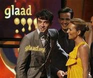"<p>Michael Urie (L), Christopher Gorham (C) and Becki Newton, stars of the comedy television series ""Ugly Betty"", accept the best comedy series award for the series at the 19th Annual Gay & Lesbian Alliance Against Defamation (GLAAD) Media Awards in Hollywood, California April 26, 2008. REUTERS/Fred Prouser</p>"