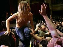 "<p>Iggy Pop returns to the stage after diving into the crowd during a performance with ""The Stooges"" on his 60th birthday at the Warfield Theatre in San Francisco, California April 21, 2007. REUTERS/Robert Galbraith</p>"