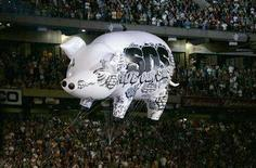 <p>An inflatable pig with environmental message floats above the Live Earth New York concert during Pink Floyd member Roger Water's set in East Rutherford, New Jersey in this file photo from July 7, 2007. REUTERS/Mike Segar</p>