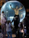 <p>File photo shows magician David Blaine outside his water-filled glass sphere where he is spending seven days and nights underwater at Lincoln Center in New York May 6, 2006. Blaine set a world record for underwater breath holding on Wednesday when he stopped breathing for more than 17 minutes suspended in a water-filled sphere on the stage of Oprah Winfrey's talk show. REUTERS/Brendan McDermid</p>