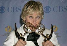 """<p>Ellen DeGeneres holds her two awards for outstanding talk show host for her program """"The Ellen DeGeneres Show"""" and for outstanding talk show at the 34th Annual Daytime Emmy Awards in Hollywood, California, June 15, 2007. DeGeneres was nominated for a Daytime Emmy again this year. REUTERS/Fred Prouser</p>"""