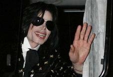 "<p>U.S. pop star Michael Jackson waves to fans as he leaves after the ""Premium VIP Party with Michael Jackson"" in Tokyo March 8, 2007. REUTERS/Kiyoshi Ota</p>"