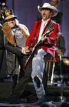 "<p>Kenny Alphin (L) and John Rich of Big and Rich perform ""Loud"" at the 41st annual Country Music Awards in Nashville, Tennessee November 7, 2007. REUTERS/Lucas Jackson</p>"