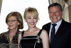 """<p>Australian singer Kylie Minogue poses with her mother Carol (L) and her father Ron during an award ceremony at the French ministry of Culture in Paris May 5, 2008. Minogue received the order of """"Arts et Lettres"""" medal from France's Minister for Culture and Communication Christine Albanel. REUTERS/Charles Platiau</p>"""