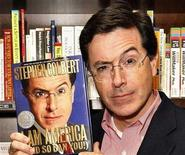 "<p>Stephen Colbert poses with his new book ""I Am America (And So Can You!)"" at a book signing in New York October 24, 2007. REUTERS/Lucas Jackso</p>"