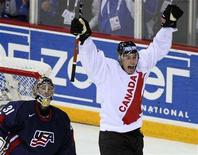 <p>Canada's Ryan Getzlaf (R) celebrates his assist on the game-winning goal by Dany Heatley in front of Team USA goalie Craig Anderson (L) during the third period of play at the 2008 IIHF World Hockey Championships in Halifax, May 6, 2008. REUTERS/Paul Darrow</p>