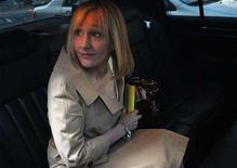 <p>J.K. Rowling, author of the Harry Potter book series, sits in her car in New York April 15, 2008. REUTERS/Joshua Lott</p>