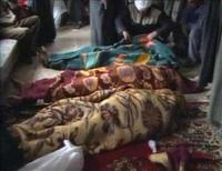 <p>A video provided to Reuters on March 21, 2006 by Hamourabi Human rights group shows covered bodies, which Hamourabi says, are of a family of 15 shot dead in their home in Haditha, in western Anbar province, Iraq. REUTERS/Hammurabi Organisation via Reuters TV</p>