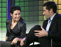 "<p>Stars of the Disney/ABC series ""Lost"", Evangeline Lily (L) and Matthew Fox (R), talk in Las Vegas, Nevada January 8, 2007. REUTERS/Rick Wilking</p>"