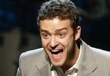 """<p>Justin Timberlake reacts as he holds during the 25th Annual ASCAP Pop Music Awards in Hollywood, April 9, 2008. MTV said on Friday it will air a new reality game show called """"The Phone"""" to be executive-produced by the pop star. REUTERS/Danny Moloshok</p>"""